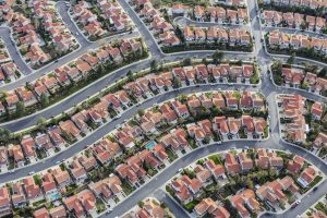 Aerial view of homes in a tightly packed suburb.