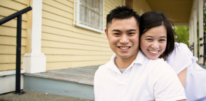man and woman smiling on a front porch