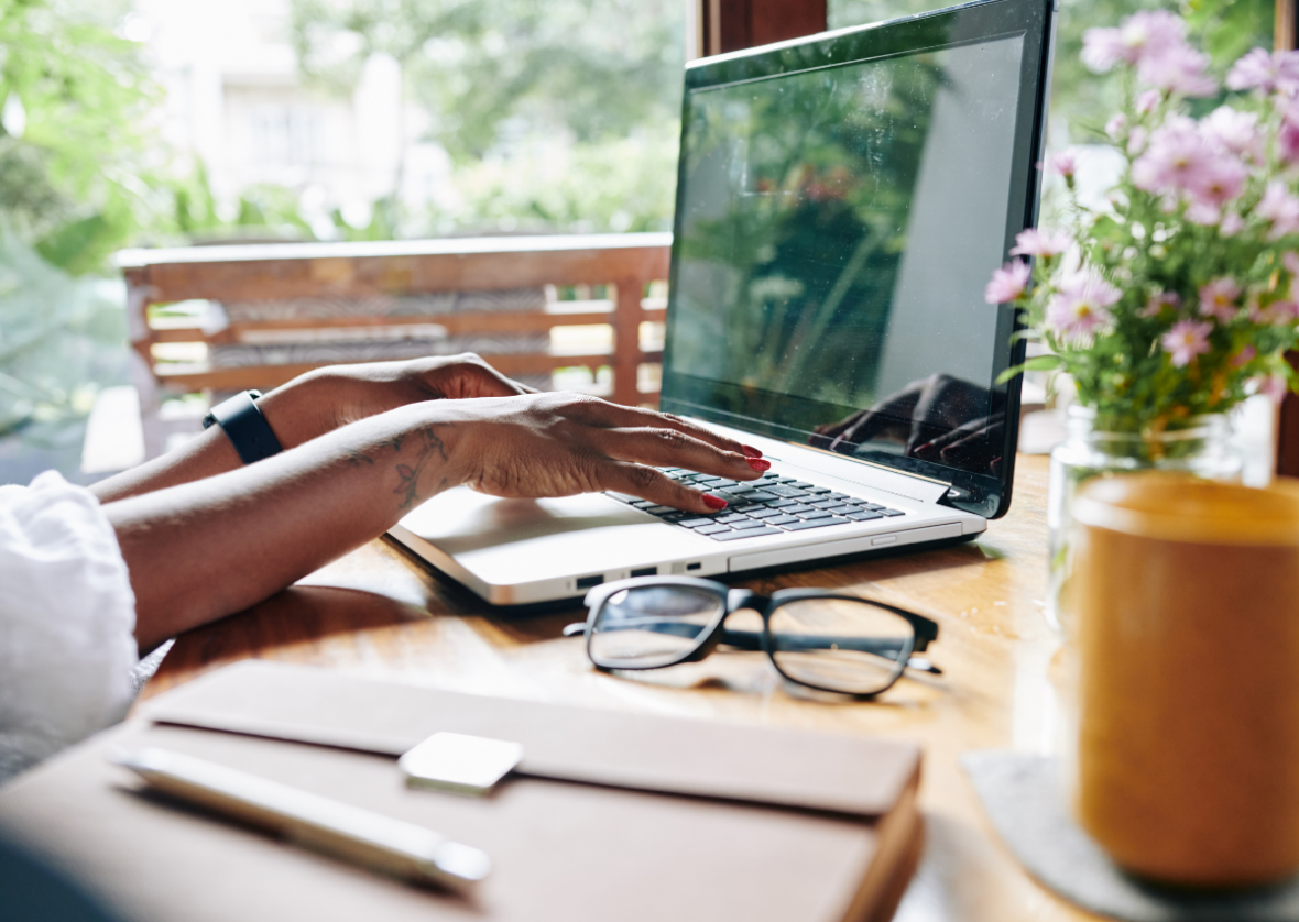 woman's hands on laptop, working from home