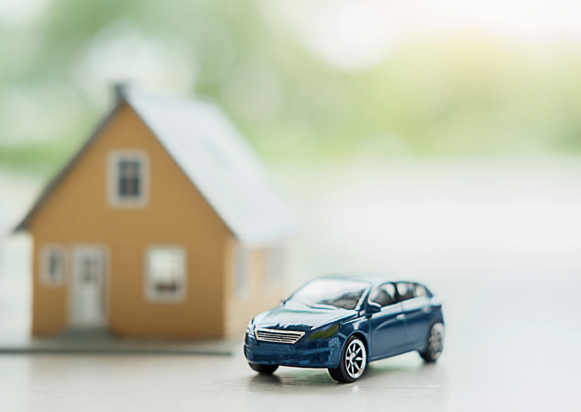 toy car and cardboard house with white background
